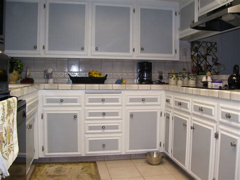 kitchen white kitchen cabinet grey door brown tile floor ceramic tile wall banana brown bowl