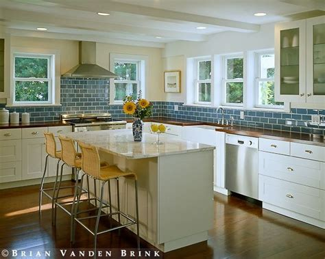 white cabinets with butcher block top butcher block counter tops in blue and white kitchen