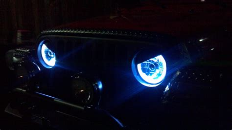 jeep headlights at night blue halo s a must have for any jeep wrangler jeep