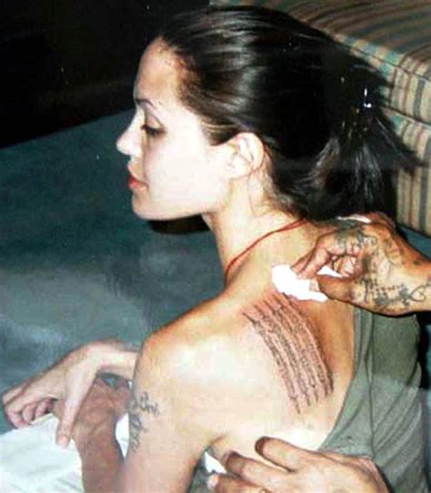 tattoo on angelina jolie s hand angelina jolie tattoos from billy bob to brad pitt s