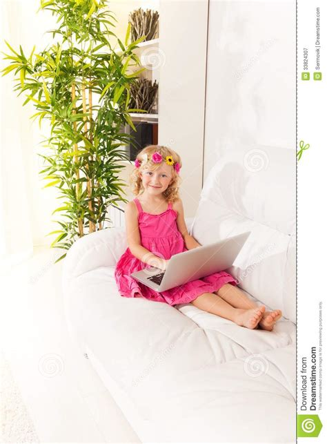 little girl couches happy little girl with sofa typing royalty free stock