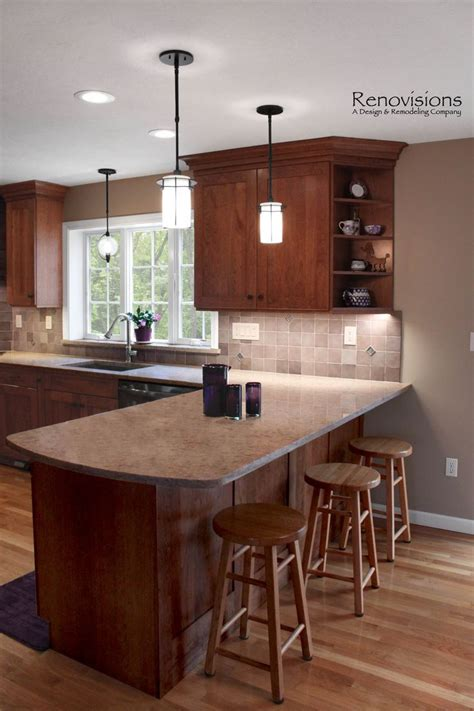 kitchen peninsula lighting 25 best ideas about cherry kitchen cabinets on pinterest