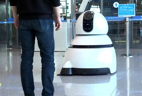 cleaning robot lg s new airport robots will guide you to your gate and clean up your trash the verge