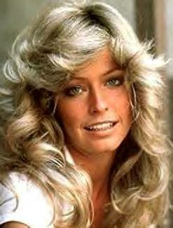hairstylist giving a customer the 1970 s feathered look beautytiptoday com 2010 s wavy hairstyles inspired by the