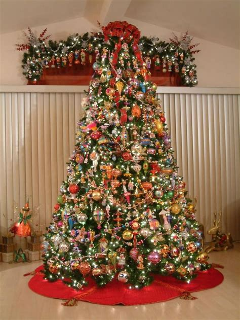 ten foot tree filled with christopher radko ornaments