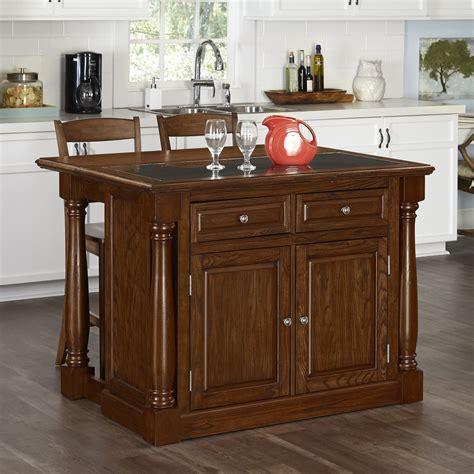 oak kitchen islands home styles monarch oak kitchen island and two stools