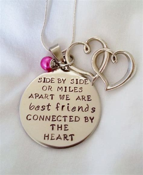 side by side best friends connected by the heart hand