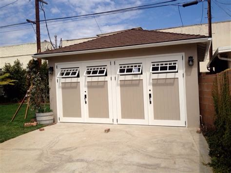 swing carriage garage doors swinging carriage garage door with functional windows yelp