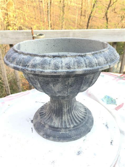 faux concrete paint creating a concrete urn with faux concrete paint