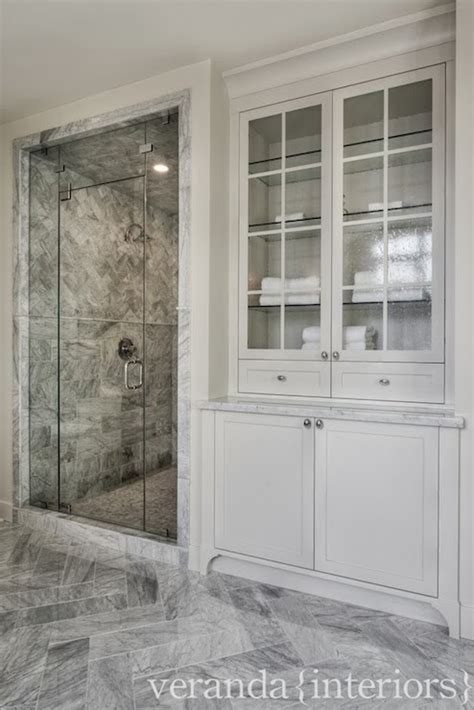 how to see through bathroom glass see through cabinets cottage bathroom eric roth photo