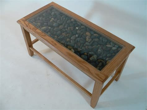 wood base glass top coffee table to clean or add accent