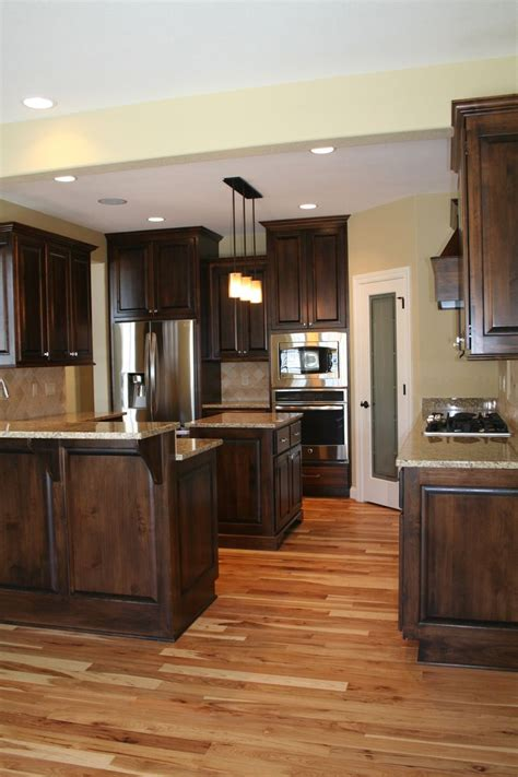 wood kitchen cabinets with wood floors best 25 dark wood cabinets ideas on pinterest dark wood