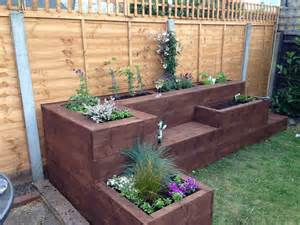 raised flower bed i would make this out of sleepers but i