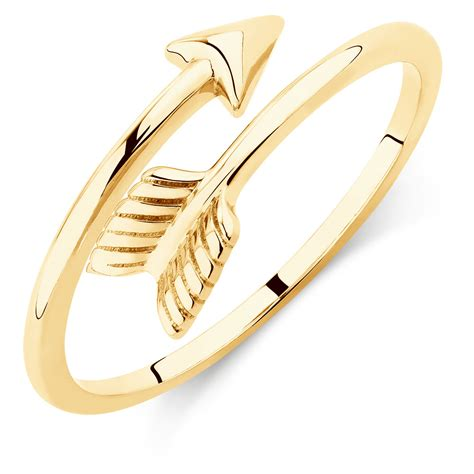 a gold ring arrow wrap ring in 10kt yellow gold