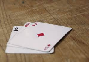 three aces cards on wooden table free stock photos libreshot