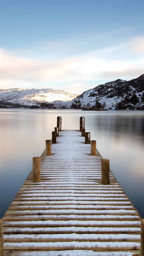 mountain lake snowy pier android wallpaper