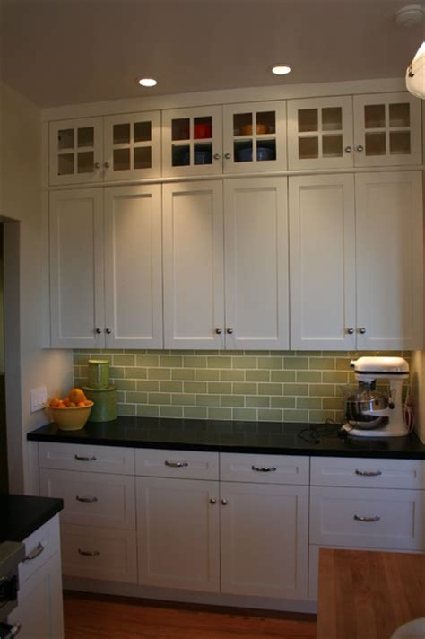 Kitchen Remodeling Designs by Glass Doors On Top Lighten The Bank Of Cabinets Without