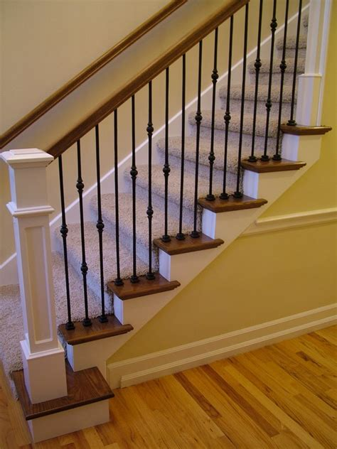 iron banisters wood staircases with iron balusters