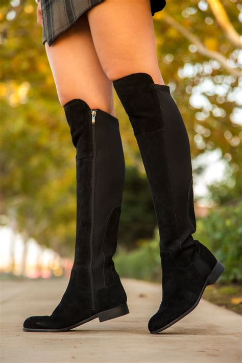 the knee black boots why you need a pair of the knee flat boots