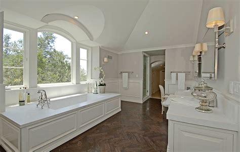 wood floor in bathroom wood herringbone floor transitional bathroom