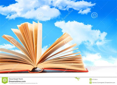 sky at noon a novel books open book against a blue sky stock images image 9717614