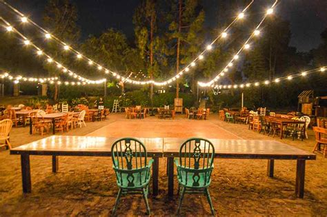 market lights string lights in backyard wedding outdoors