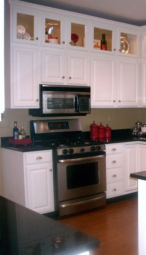 what to put on top of your kitchen cabinets things to put on top of kitchen cabinets all kitchen