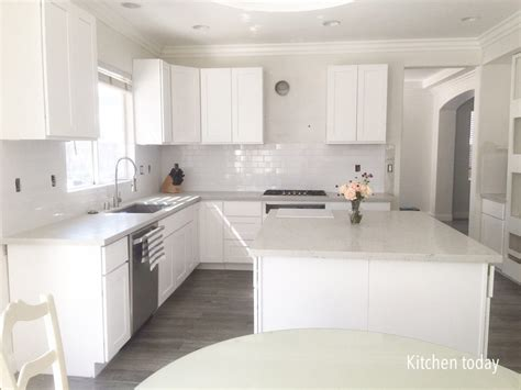 gray shaker kitchen cabinets with engineered white quartz white shaker cabinets with gray quartz countertops