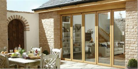 Barn Conversion Doors Bifold Door Glass That Gives You Bbq Weather Indoor Out