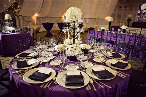 purple and white centerpieces for weddings black white and purple wedding reception via weddingwoof