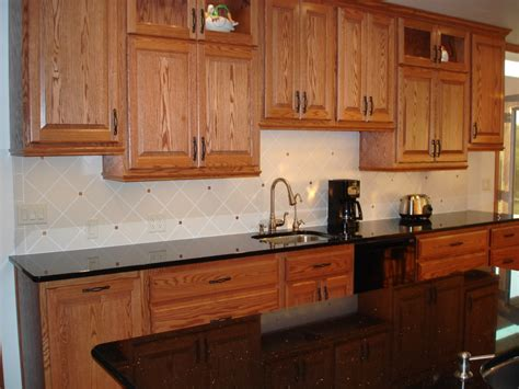backsplash pictures with oak cabinets and uba tuba granite