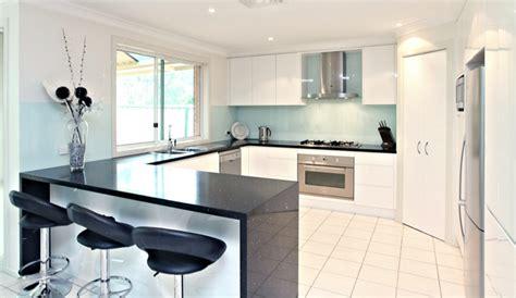 black splash kitchen kitchen glossy white cabinets black quartz bench top