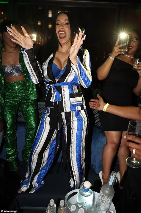 cardi b flashes fans cardi b masks baby bump yet flashes cleavage in