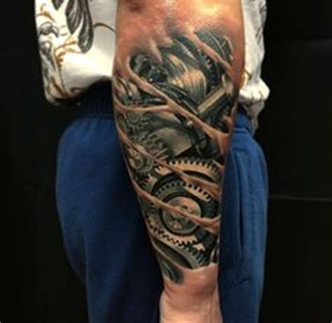 tattoo pedro quebec male full sleeves mechanical gear tattoo full and half