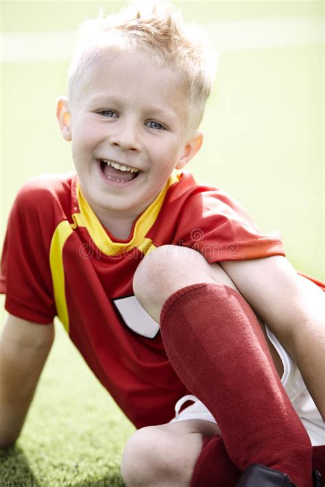 what to get a 7 year old for xmas boy sitting on football field stock photo image 40915743