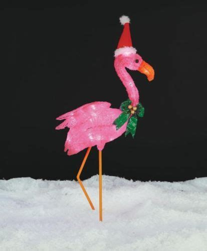 christmas lighted flamingo with santa hat outdoor