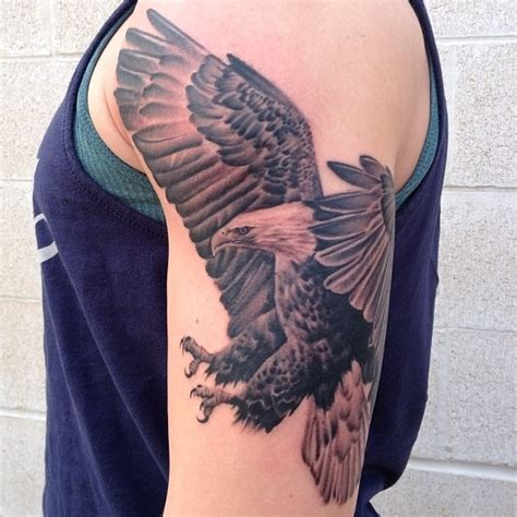 eagle quarter sleeve tattoo 48 awesome flying eagle tattoos