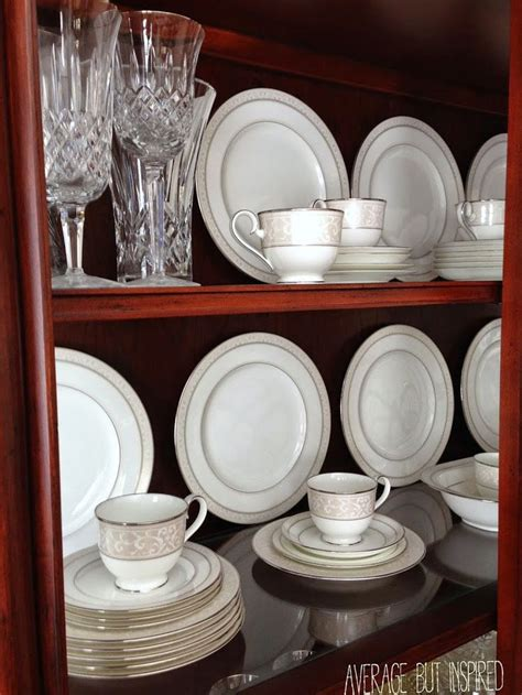How To Organize Dishes In Cabinets tips on how to arrange a china cabinet cabinets tips