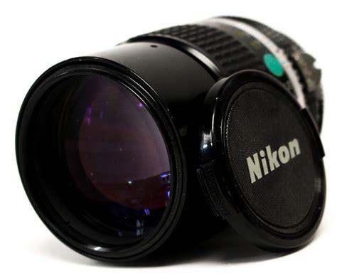 nikon a nikkor 1 2 8 135mm lens serial number 912464 with lens cap