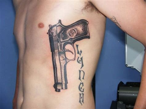 pistol tattoo 40 mind blowing gun tattoos on rib