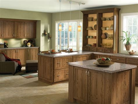 corner cabinets for kitchens rustic wood species and clean door styles give this kitchen an inviting comfortable look