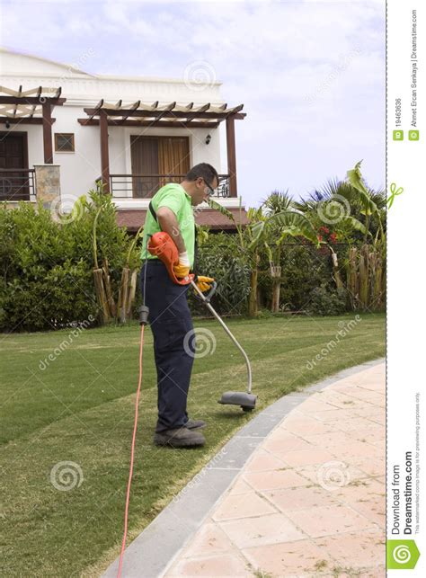 a gardner a gardner with a weed wacker royalty free stock image