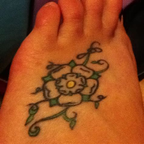 yorkshire rose tattoos done by tristan at inkwell in crewkerne