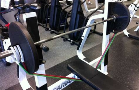 assisted bench press bar weight build a bigger bench with band presses stack