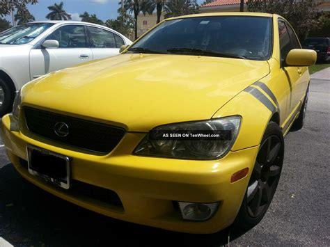 yellow 2002 lexus is300 base sedan 4 door 3 0l