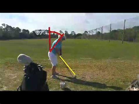 left shoulder under chin golf swing golf backswing left shoulder down body for golf swing