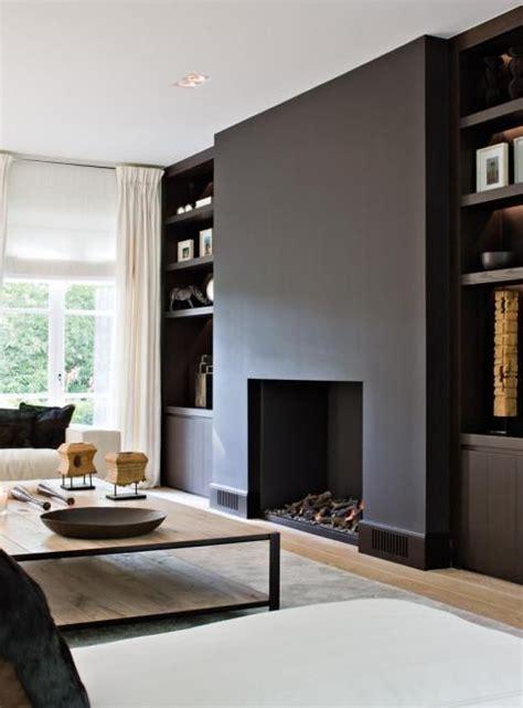 modern black fireplace inbouwhaard in zwarte muur schouw interieur haard