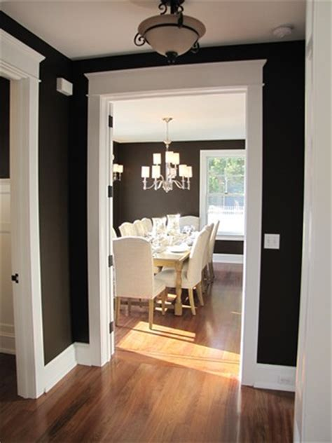 black painted room looking into black painted dining room hooked on houses
