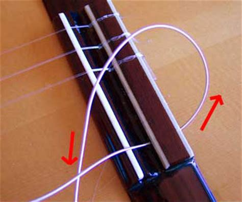 How To Tie A Knot With 3 Strings - restringing a classical guitar how to tie those knots