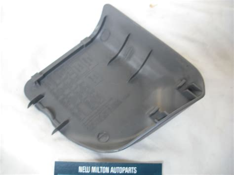 mazda  interior fuse box cover trim  rhd cars gja   grey